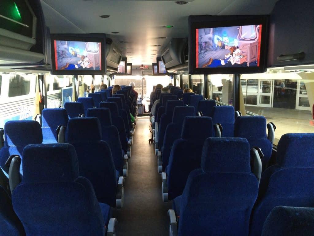 The inside of a Magical Express Walt Disney World bus.